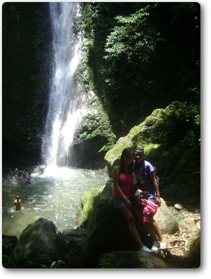 pose in front of the waterfall basin